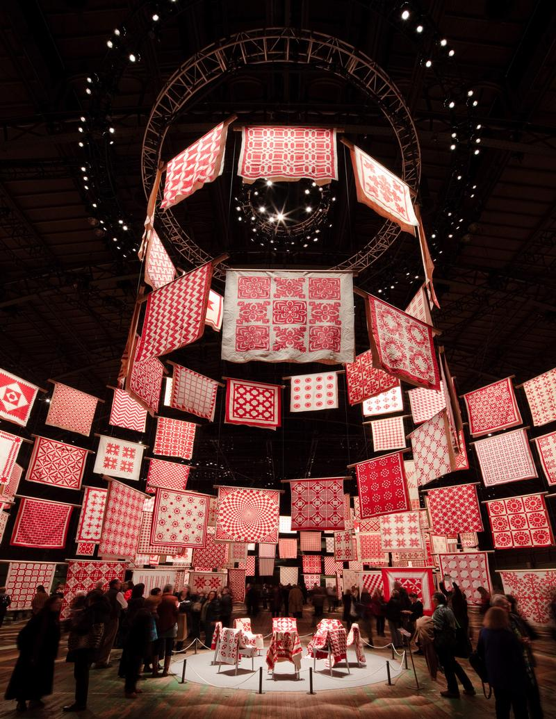 The heart of the exhibition was this spiral of quilts rising above a ring of chairs representing three centuries of quilters. /Credit:Tom Hennes