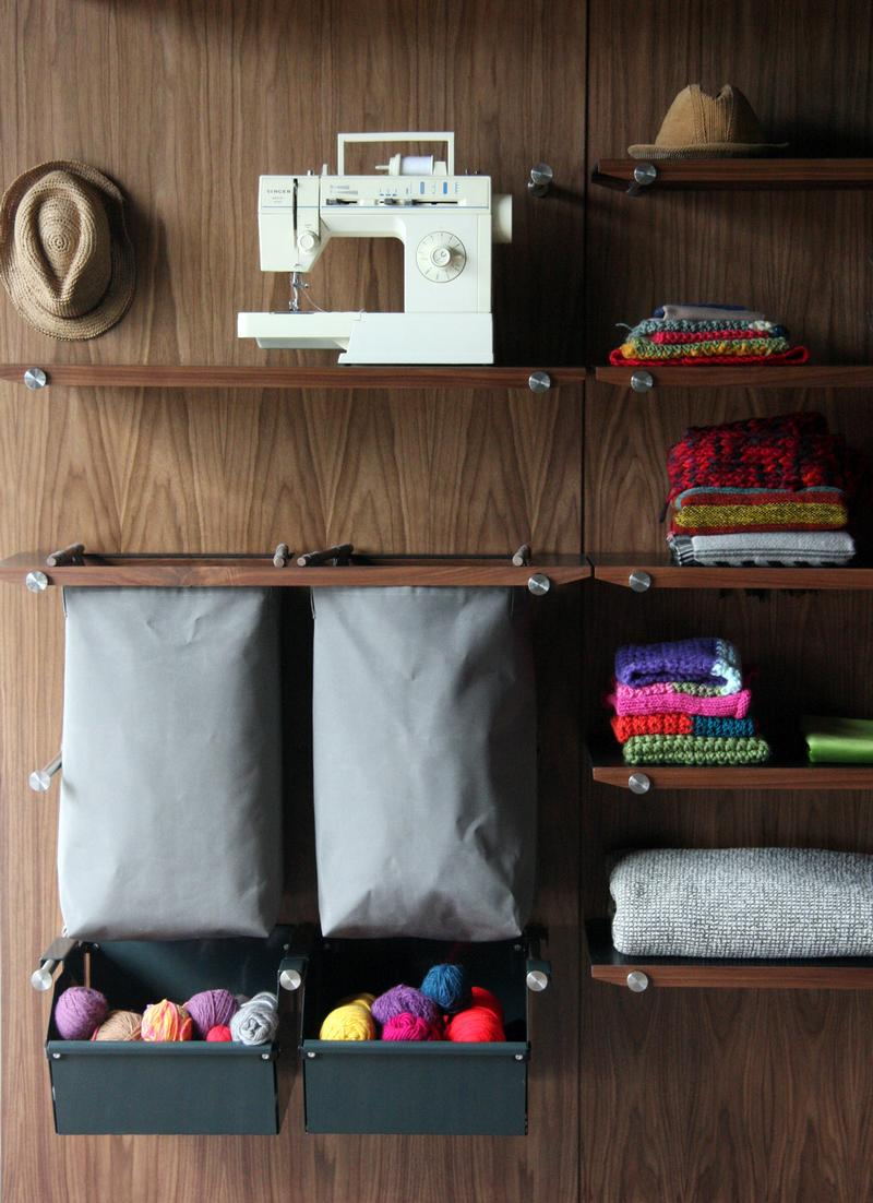 Shelves, softgoods bags, and powder coated steel bins.